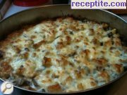 Potatoes baked with cheese and mushrooms