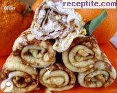 Orange pancakes stuffed with cottage cheese