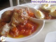 Chicken in tomato sauce with fried eggs
