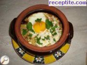 Eggplant with eggs and feta cheese in a pot