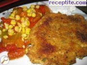 Chicken cutlets with processed cheese in the oven