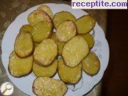 Baked potatoes on salt