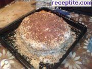 Home layered cake with starch, walnuts and chocolate