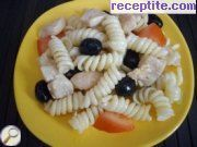 Salad with pasta, chicken and olives