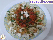 Colorful pasta with tomato sauce