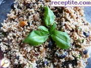 Quinoa salad with olives, dried tomatoes and basil