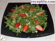 Fresh salad with arugula, strawberries and nuts