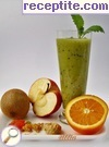 Smoothie with kiwi, orange, apple and dried fruit
