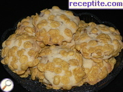 Cookies with pine nuts and flakes
