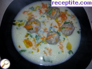 Meatballs in white sauce with orange sauce