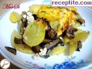Dish with zucchini, potatoes and mushrooms in the oven