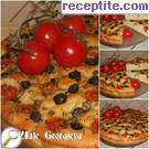 Focaccia with cherry tomatoes, olives and oregano