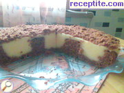 снимка 12 към рецепта Дупчен сладкиш с пудинг и сметана